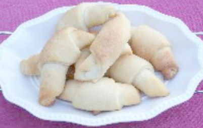 Crescent Rolls for dinner are made with yeast and lots of butter. They are light and airy to melt in your mouth.