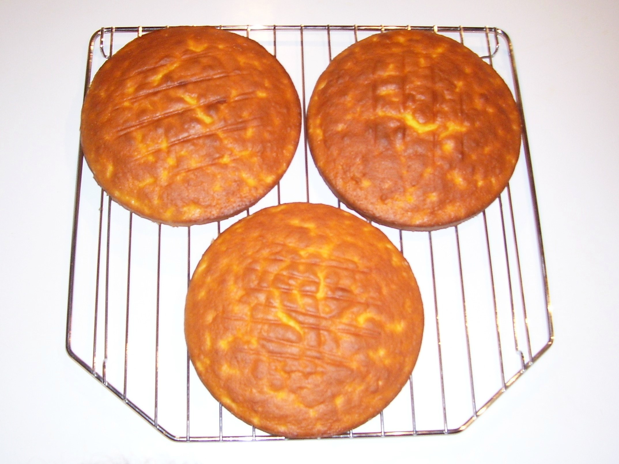 Simple Three Layer Cakes made with boxed Cake Mix and mandarin oranges.