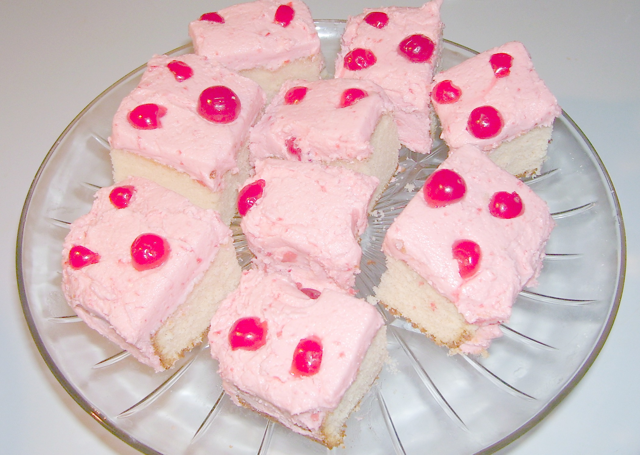 Maraschino Cherry Cake Recipe Squares with yummy Cherry Cream Cheese Frosting.