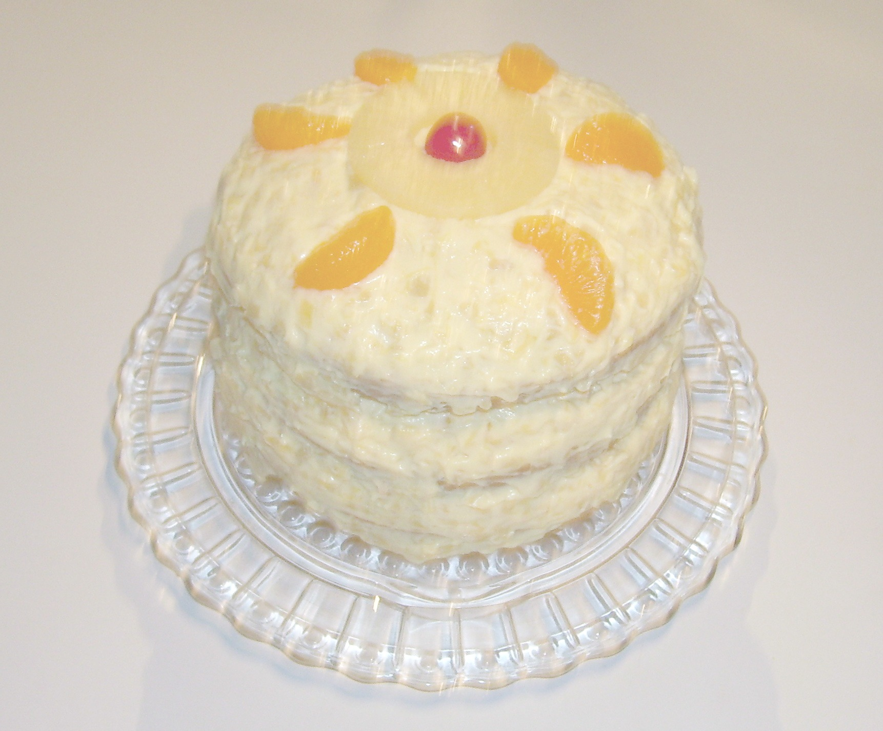 Pig Pickin Cake Recipe, an Old Fashioned Cake Recipe made moist and delicious with Mandarin Oranges and Pineapple.