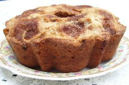 Sour Cream Cinnamon Coffee Cake with raisins and nuts.