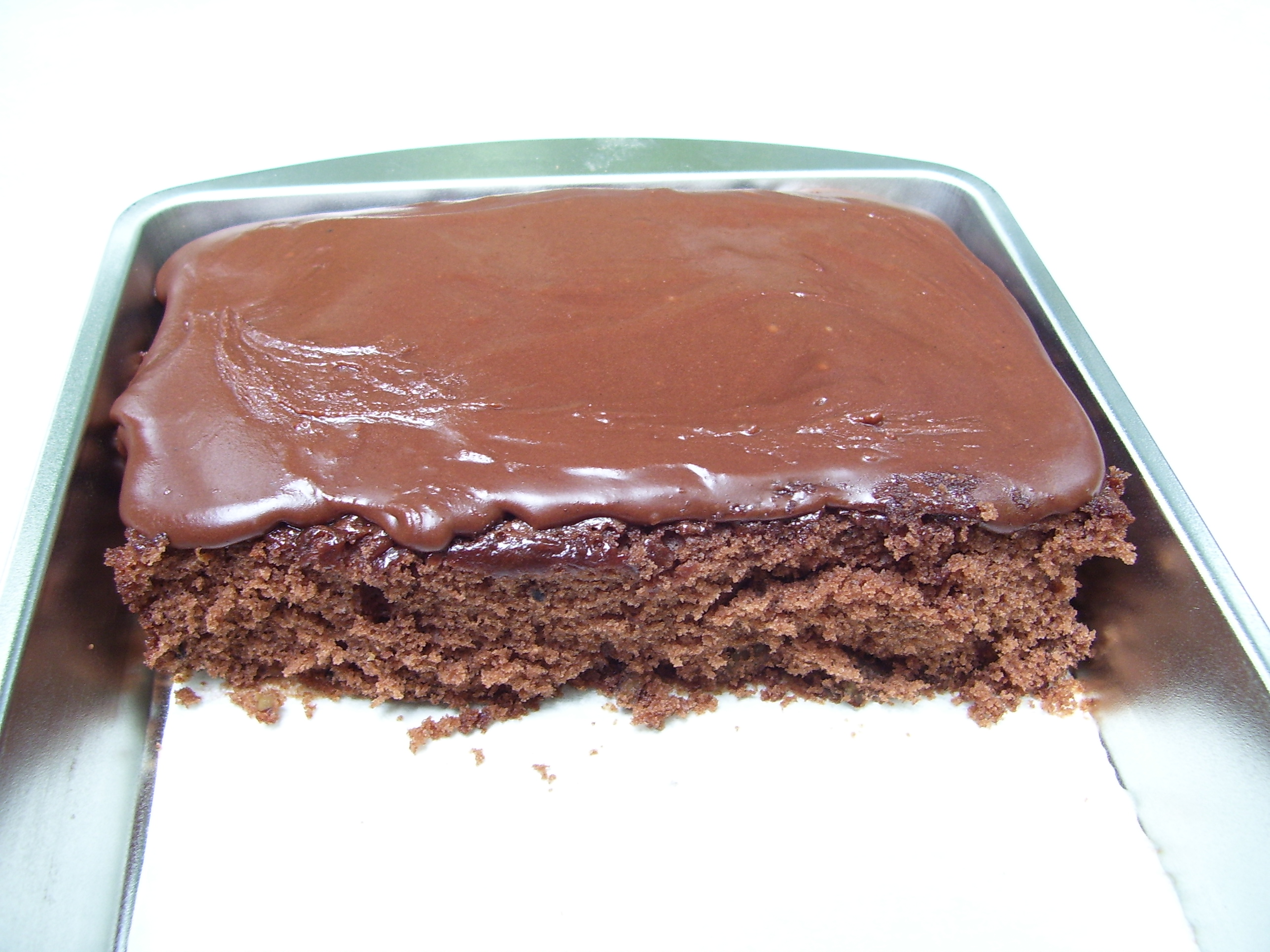 Texas Sheet Cake Recipe makes a cake delicious, decadent cake that is terrific for a crowd.