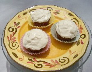 Moist Applesauce Cupcakes or Muffins with a light spice flavor.