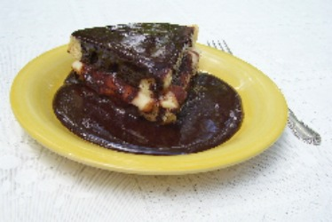 Boston Cream Pie Recipe with Sweet Vanilla Pudding topped with Chocolate Sauce.