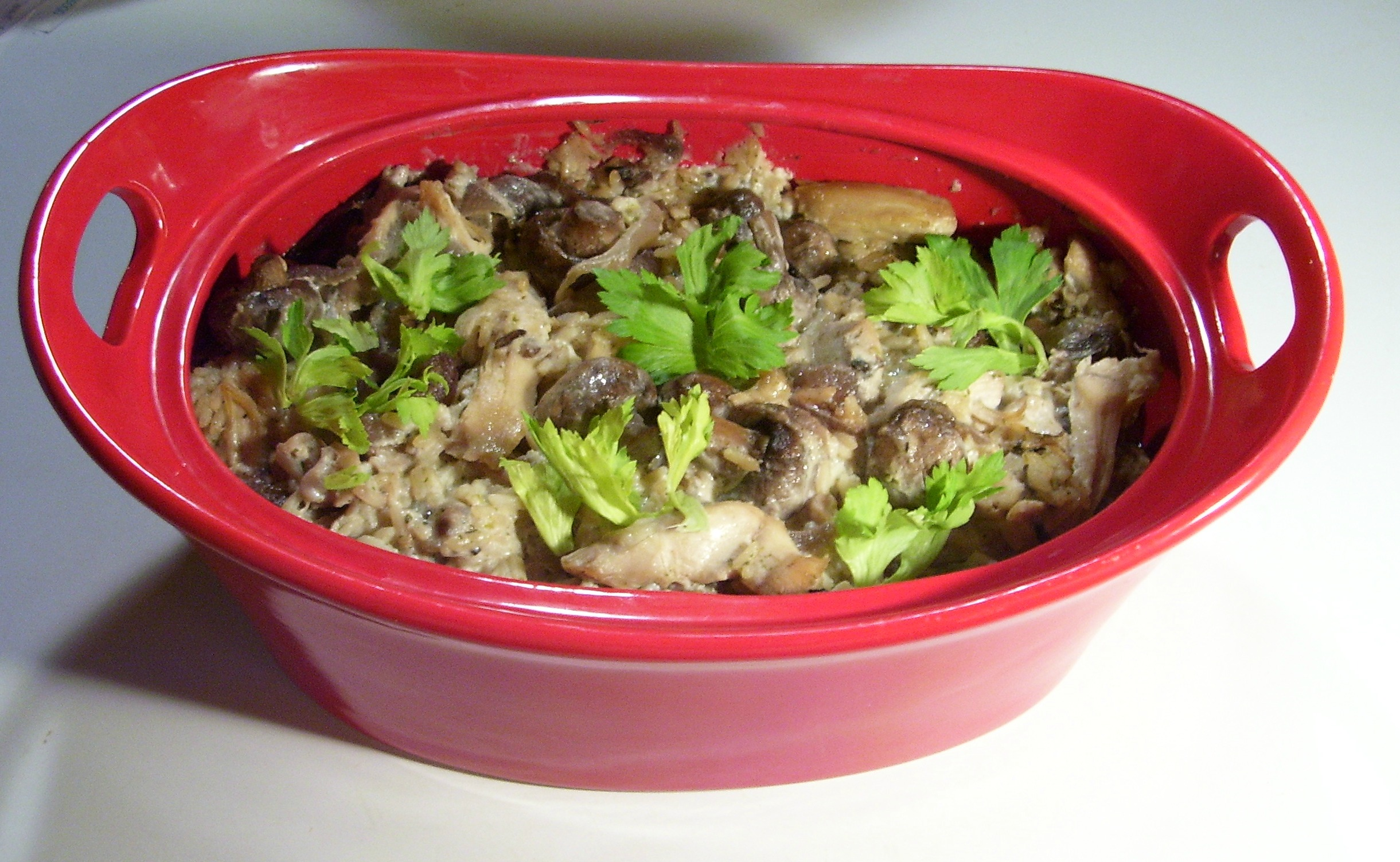 Chicken And Wild Rice Casserole with sauteed fresh mushrooms, caramelized onions, and dry sherry.