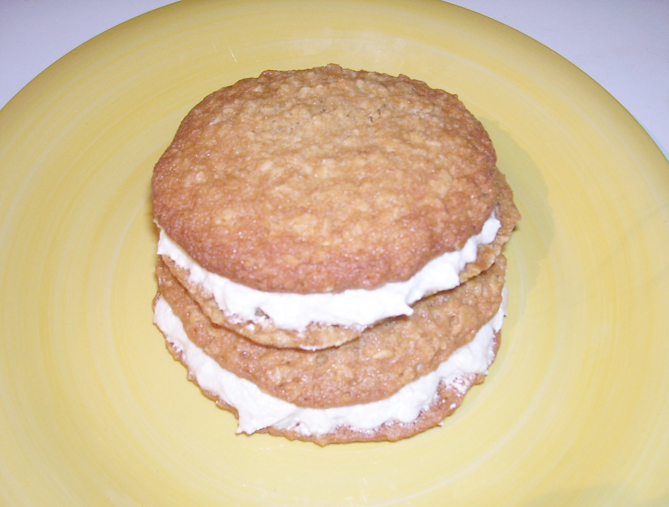 Old Fashioned Oatmeal Sandwich Cookie Recipe with luscious, creamy filling makes the best oatmeal cookie, ever.