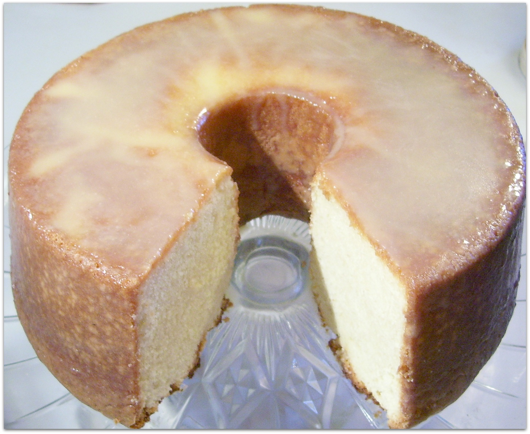Homemade Old Fashioned Sour Cream Cake Recipe with a thin glaze with make your cake look and taste like bakery-made.