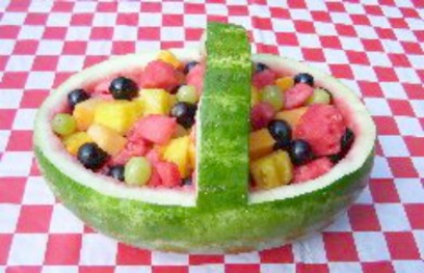 Watermelon Basket Salad full of juicy fruits.